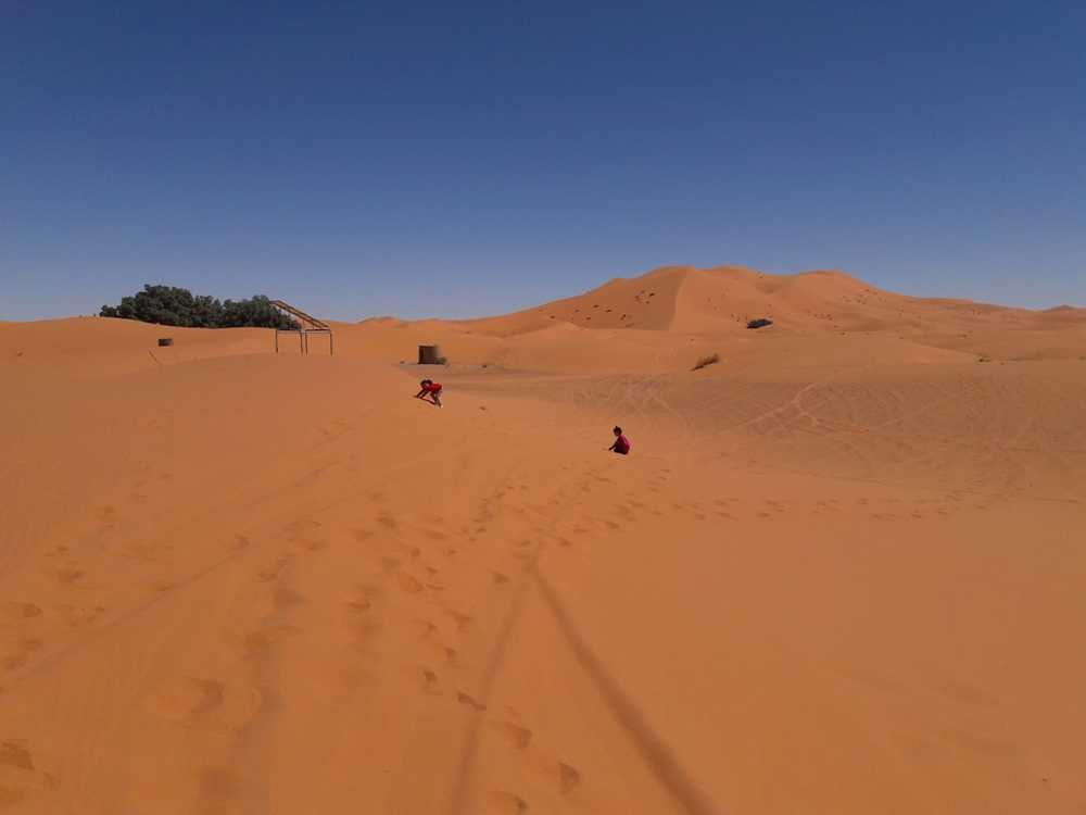 Merzouga - My little girls playing on sand